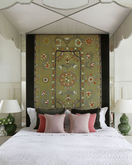 Vintage chic: Antique fabric on mirrored four-poster bed frame, POA, VSP Interiors. Picture: PA Phot