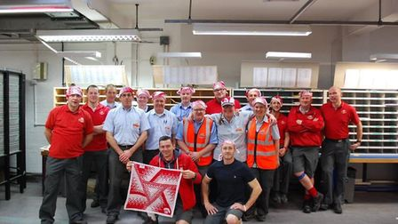 Posties at St Ives sorting office with their bandanas. PICTURE: Colin Rich