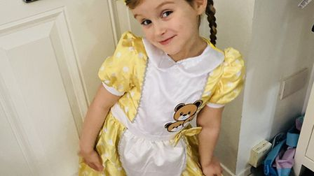 Evie-Grace Hammond dresses as Goldilocks with three bears on her dress. Picture: Courtesy of Alice H