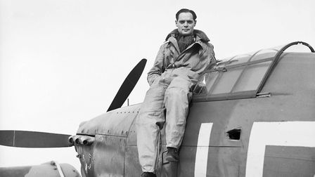 Squadron Leader Douglas Bader of 242 (Canadian) Squadron, seated on the cockpit of his Hurricane at