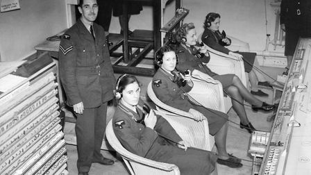 WAAF plotters in the Sector 'G' Operations Room at RAF Duxford, receiving reports of enemy aircraft