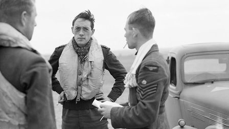 Squadron Leader Brian 'Sandy' Lane of 19 Squadron (centre) confers with Flight Lieutenant Walter 'Fa