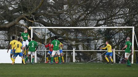 Josh Crawley scores the winning goal for Newport Pagnell. Picture: JAMES LATTER