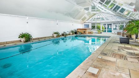The pool house at Cunningham Hill Road includes a heated pool, sauna, Jacuzzi and shower/cloak facil