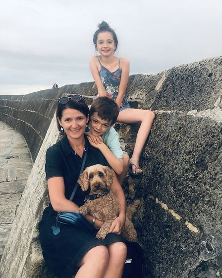 Claire Gillies with her children Evie and Sam and Scout the cockapoo.