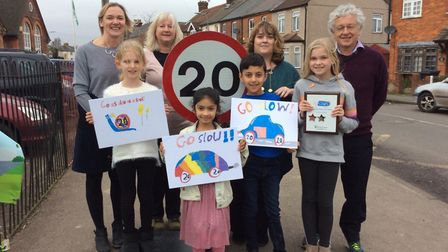 Camp School pupils made posters asking drivers to slow down outside their school in St Albans. Pictu