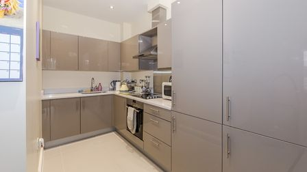 The kitchen opens onto the living area. Picture: Ashtons