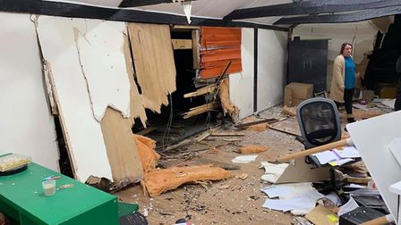 Police are investigating after a car crashed into the office block.