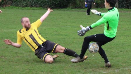 Beehive's Lee Gibbon forces the ball past Phoenix keeper Dan Margott for the opening goal. Picture: