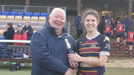 OA Saints' player of the match Steph Plunkett receives her prize from Old Albanian's vice-chairman I