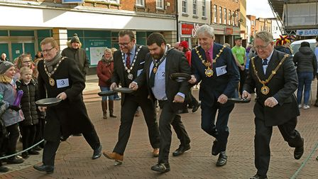 The mayors in full swing at the pancake race in Huntingdon