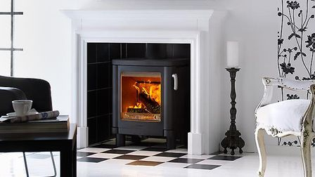 Maximise the efficiency of your wood burner with a A Contura 51L Ecodesign ready stove. Picture: Con