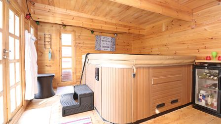 The cabin comes with its own hot tub - and could also be used as a home office. Picture: Paul Barker