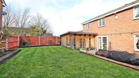 There is a private garden to the rear with a generous patio and beautifully manicured lawn. Picture: