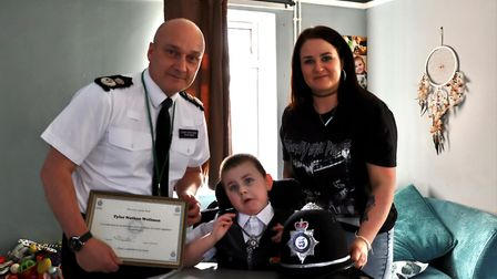 Tyler with Chief Constable Nick Dean and mum Amiee PICTURE: Cambs police
