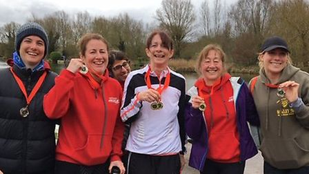 One of the successful Harpenden Arrows ladies' teams show off their medals from the Hertfordshire Ma