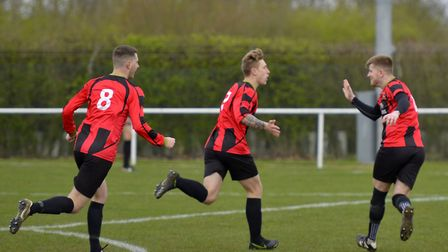 Archie Sayer (centre) celebrates his debut Huntingdon Town goal which put them ahead against Blackst