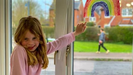 Six year old Elise Laborne pointing at her rainbow she made PICTURE: Peter Laborne