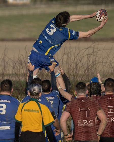 Tom Ransom gets airborne to win a lineout during St Ives' success against Melton Mowbray. Picture: P