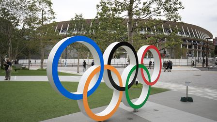The Olympic Rings stand outside the Olympic Stadium in Tokyo, Japan. Picture: ADAM DAVY/PA