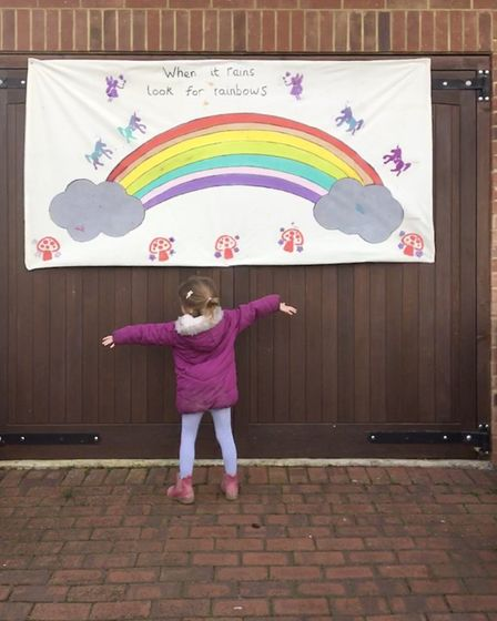 A St Albans pupil enjoying cheering people up with her rainbow amid Coronavirus pandemic. Picture: S