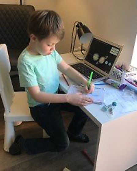 Luca, 6, doing his work at home during the Coronavirus school shutdown. Picture: Supplied