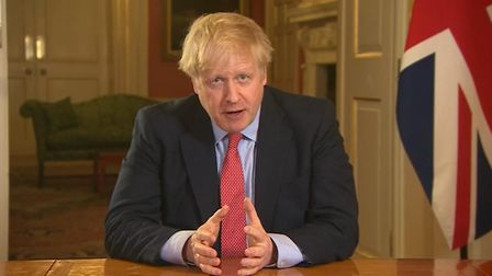 Prime Minister Boris Johnson addressing the nation from 10 Downing Street, London, as he placed the
