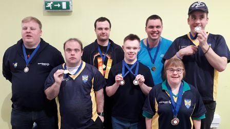 Some the St Albans Special Olympics swimmers with their medals.