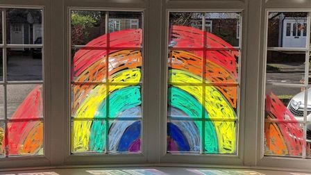 Alette Addison took to drawing her rainbow directly on to the window. Picture: Alette Addison