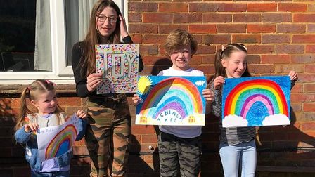 Evie, Lillie, Finley and Maggie Cullen showing off their rainbow creations as part of the St Albans