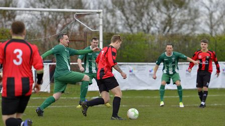 Archie Sayer opens the scoring for Huntingdon Town against Blackstones in the last non-league game t