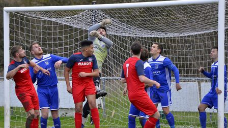 Godmanchester Rovers in action against Hadleigh United in the Thurlow Nunn League Premier Division i