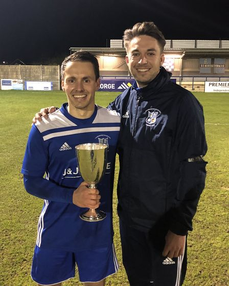 Godmanchester Rovers captain Micky Hyem and manager Ollie Drake show off the Hunts Senior Cup. Pictu