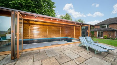 Bi-fold doors open from the pool room to the sun terrace. Picture: Bradford & Howley