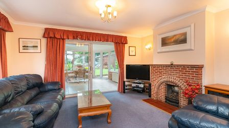 The light and spacious lounge features a superb fireplace with brick surround and gas fire. Picture:
