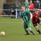 Action from Huntingdon Town's clash with Blackstones in the United Counties League on March 14. Pict