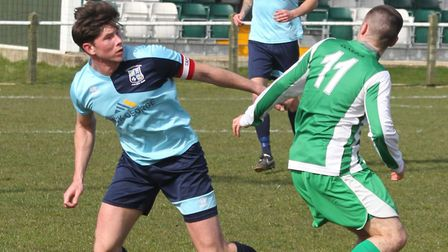 Defensive colossus Taylor Parr in action for Godmanchester Rovers. Picture: STEVE UNWIN
