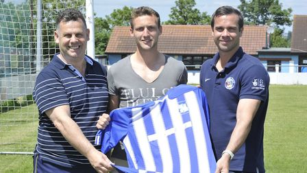Jason King (centre) signing for Godmanchester Rovers with Nev Nania (left) and Matty Hanniver (right