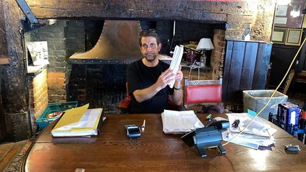 Ye Olde Fighting Cocks landlord ChristoTofalli with a stack of bills unpaid despite customers being