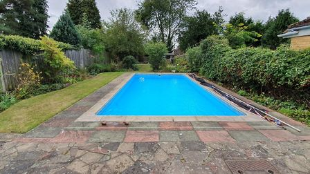 Not many Bricket Wood semis come complete with their own heated pool. Picture: Bradford & Howley