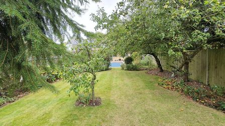 The rear garden is one of the property's main selling points. Picture: Bradford & Howley