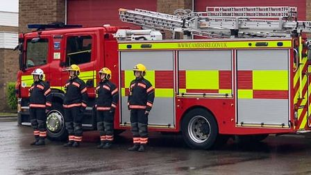 A fire crew in St Neots taking a 1 minute silence for all people who have lost their lives to Covid-