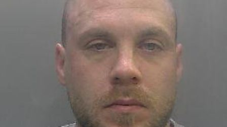 Steven Clegg has been jailed after he punched, spat and bit police officers in Huntingdon