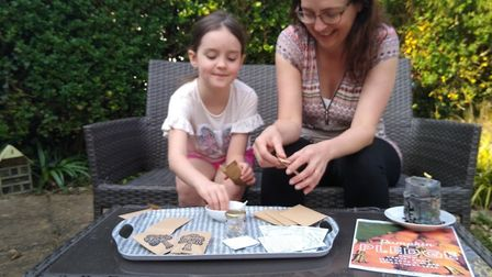 Kate Swindells and her daughter pack seeds for Grow Community - Sopwell's seed swap project in St Al