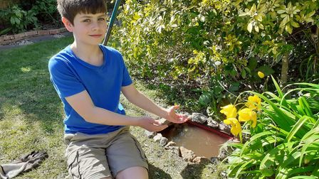 Ben Mitchell shows off his newly created garden mini pond. Picture: Isobel Mtichell