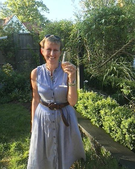 Michaela Vaux in her garden toasting the 20th anniversary of Bumpkins Nursery in Whaddon. Picture: S