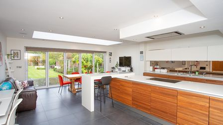 There is a stylish open plan kitchen/breakfast room to the rear. Picture: Frost's
