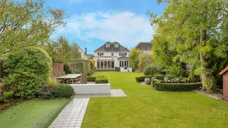 Features of the rear garden include a built in BBQ area, a fire pit and an artificial putting green. Picture: Frost's