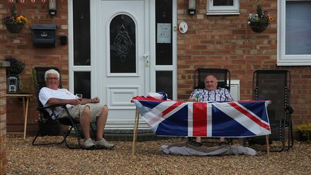Residents Kevin and Mark with their union jack at the front of their house. Picture: SARAH BECK