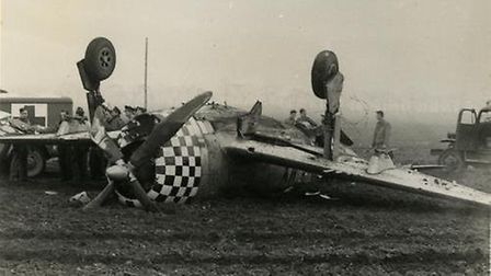 A P-47D Thunderbolt of the American 78th Fighter Group that flipped over and crashed at Duxford airb